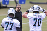 Carolina Panthers head coach Matt Rhule talks to rookies Deonte Brown (77) and Brady Christensen during NFL football rookie minicamp in Charlotte, N.C., Saturday, May 15, 2021. (AP Photo/Nell Redmond)