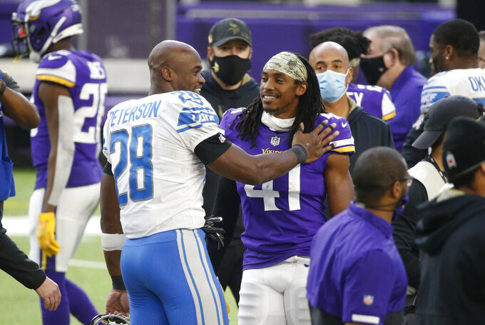 Detroit Lions running back Adrian Peterson (28) talks with Minnesota Vikings safety Anthony Harris (41) after an NFL football game, Sunday, Nov. 8, 2020, in Minneapolis. The Vikings won 34-20. (AP Photo/Bruce Kluckhohn)