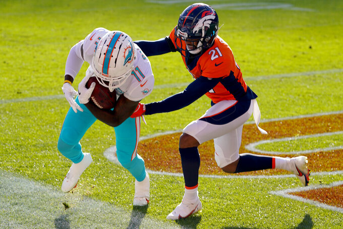 Miami Dolphins wide receiver DeVante Parker (11) pulls in a touchdown catch as Denver Broncos cornerback A.J. Bouye (21)defends during the first half of an NFL football game, Sunday, Nov. 22, 2020, in Denver. (AP Photo/David Zalubowski)