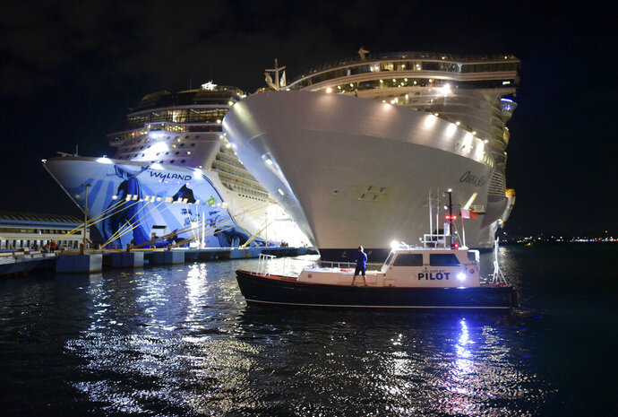 Local authorities join the U.S. Coast Guard on a search of a person who reportedly went overboard from a cruise ship just off Puerto Rico's north shore, in San Juan, Puerto Rico, Wednesday, Jan. 22, 2020. According to Coast Guard spokesman Ricardo Castrodad, the incident involved the Oasis of the Seas ship operated by Royal Caribbean International. (AP Photo/Carlos Giusti)