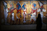 A visitor walks in 'Tutankhamun, the treasure of the Pharaoh', an exhibition in partnership with the Grand Egyptian Museum at the Grande Halle of La Villette in Paris, France, Thursday, March 21, 2019. This exhibition, which runs from 23 March to 15 September 2019. will reveal 150 fascinating original objects found in 1922 in the tomb of the most famous Pharaoh. (AP Photo/Francois Mori)