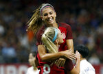 "FILE - In this Oct. 19, 2017, file photo, U. S. midfielder Julie Ertz (8) celebrates her header goal with forward Alex Morgan, rear, in the first half of an international friendly women's soccer match against South Korea in New Orleans. She's already an internationally recognized soccer player with a World Cup title and an Olympic gold medal. She's also the author of a series of kids' books. Now you can add actor to Alex Morgan's resume. The U.S. national team forward makes her theatrical debut in a new feature ""Alex & Me"" about a young player who is inspired by Morgan.  (AP Photo/Gerald Herbert)"
