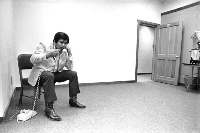 FILE - In this Feb. 14, 1978, file photo, Thomas Atcitty talks on the phone in a bare office of the American Indian School of Medicine, at Shiprock, N.M. Atcitty, a former interim Navajo Nation president and longtime New Mexico state representative has died. The tribe says Thomas Atcitty died Sunday, Oct. 11, 2020, of natural causes. He was 86. Funeral services are scheduled Wednesday ,Oct. 14, in Shiprock, N.M., where Atcitty lived most of his life. (AP Photo/Rick Browne, File)