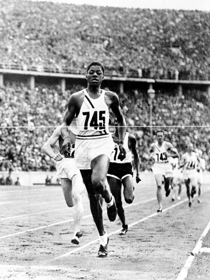 FILE - In this Aug. 8, 1936 file photo, John Woodruff, a freshman at the University of Pittsburgh, wins the 800-meter race at the Olympic Games in Berlin. (AP Photo/File)