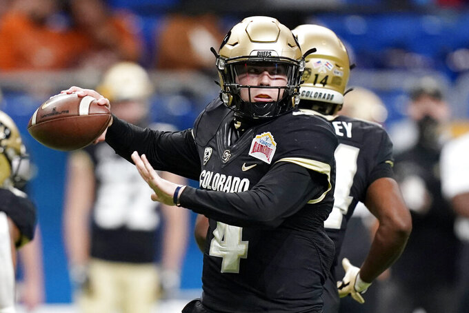 FILE - In this Dec. 29, 2020, file photo, Colorado quarterback Sam Noyer (4) looks to pass against Texas during the first half of the Alamo Bowl NCAA college football game, Tuesday,, in San Antonio. The former Colorado quarterback will be the starter at Oregon State after battling Tristan Gebbia and Chance Nolan over the past several weeks. (AP Photo/Eric Gay, File)