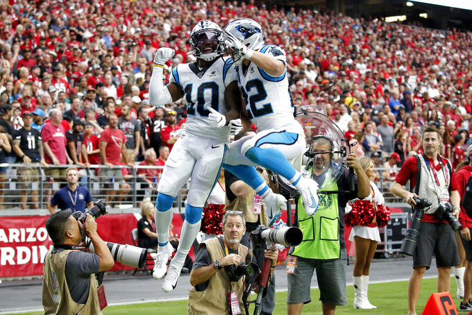 Carolina Panthers wide receiver Curtis Samuel (10) celebrates his touchdown catch with running back Christian McCaffrey (22) during the first half of an NFL football game against the Arizona Cardinals, Sunday, Sept. 22, 2019, in Glendale, Ariz. (AP Photo/Ross D. Franklin)