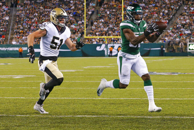 New York Jets' Ty Montgomery (88) runs away from New Orleans Saints' Colton Jumper (51) for a touchdown during the first half of a preseason NFL football game Saturday, Aug. 24, 2019, in East Rutherford, N.J. (AP Photo/Noah K. Murray)