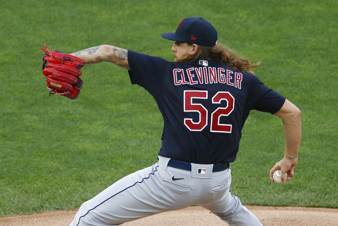 Cleveland Indians pitcher Mike Clevinger throws against the Minnesota Twins in the first inning of a baseball game Friday, July 31, 2020, in Minneapolis. (AP Photo/Jim Mone)