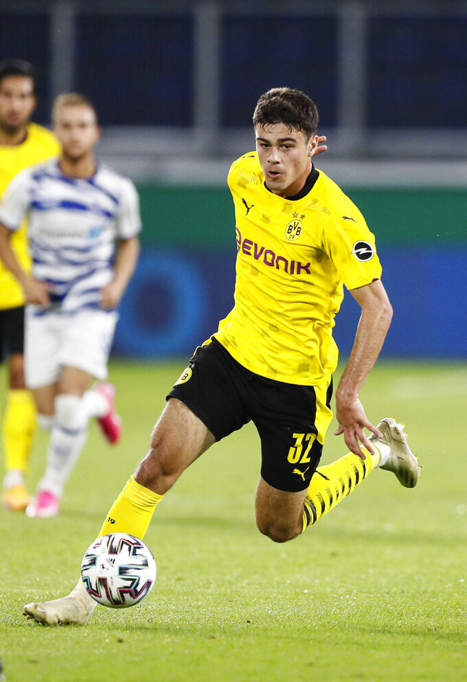 FILE - In this Sept. 14, 2020, file photo, Dortmund's Giovanni Reyna plays during a first round German Soccer Cup match against MSV Duisburg in Duisburg, Germany. Gio Reyna, a son of former U.S. captain Claudio Reyna, got his first call-up to the U.S. national soccer team. The Borussia Dortmund midfielder is part of a 24-man roster for exhibitions at Wales on Nov. 12 and against Panama four days later in Austria. (AP Photo/Martin Meissner, File)