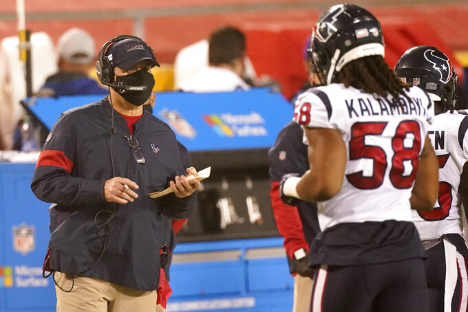 Houston Texans head coach Bill O'Brien, left, watches from the sideline in the first half of an NFL football game against the Kansas City Chiefs Thursday, Sept. 10, 2020, in Kansas City, Mo. (AP Photo/Charlie Riedel)