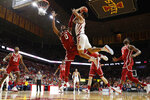 Iowa State guard Nick Weiler-Babb drives to the basket over Oklahoma guard Christian James (0) during the second half of an NCAA college basketball game, Monday, Feb. 25, 2019, in Ames, Iowa. (AP Photo/Charlie Neibergall)