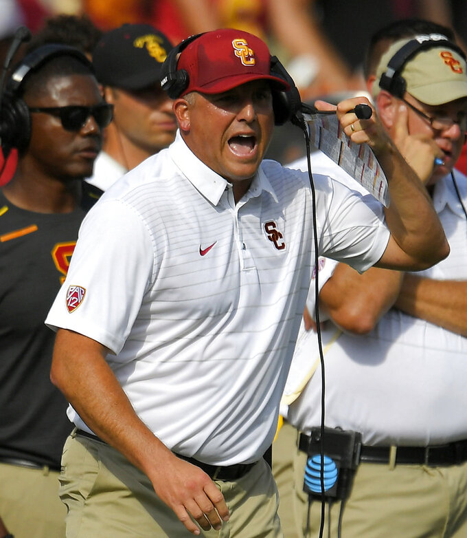 FILE - In this Sept. 2, 2017, file photo, Southern California head coach Clay Helton yells to his team during the second half of an NCAA college football game against Western Michigan, in Los Angeles. Southern California running back Aca'Cedric Ware let loose after the 37-14 loss at Texas on Saturday, lamenting poor practice habits and a lack of offensive leadership in consecutive blowout losses. When the Trojans returned to practice Monday night, Sept. 17, 2018, it looked as if coach Clay Helton had taken Ware's words to heart.  (AP Photo/Mark J. Terrill, File)