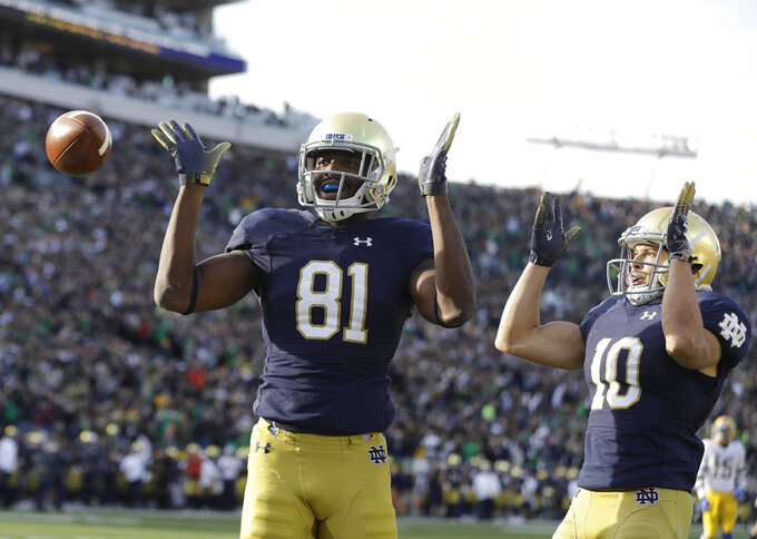 Notre Dame's Miles Boykin (81) celebrates after making the game winning catch with Chris Finke (10) during the second half of an NCAA college football game against Pittsburgh, Saturday, Oct. 13, 2018, in South Bend, Ind. Notre Dame won 19-14. (AP Photo/Darron Cummings)
