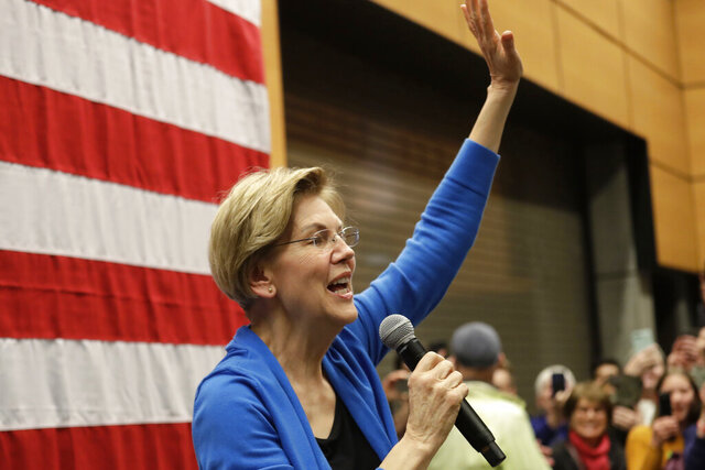 Democratic presidential candidate U.S. Sen. Elizabeth Warren, D-Mass., waves to an overflow crowd before addressing a larger rally during a campaign event Saturday, Feb. 22, 2020, in Seattle. (AP Photo/Elaine Thompson)