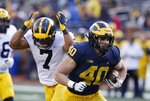 Michigan fullback Ben VanSumeren runs for a touchdown during the team's annual spring NCAA college football game, Saturday, April 13, 2019, in Ann Arbor, Mich. (AP Photo/Carlos Osorio)