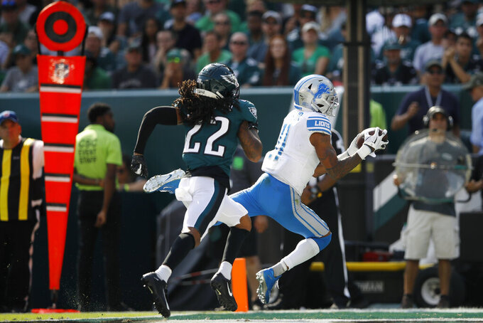 Detroit Lions' Marvin Jones, right, catches a touchdown pass against Philadelphia Eagles' Sidney Jones during the second half of an NFL football game Sunday, Sept. 22, 2019, in Philadelphia. (AP Photo/Matt Rourke)