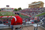 New Mexico fan Michael Hernandez looks at the scoreboard during the first half of an NCAA college football game against Fresno State in Albuquerque, N.M., Saturday, Oct. 20, 2018. (AP Photo/Andres Leighton)