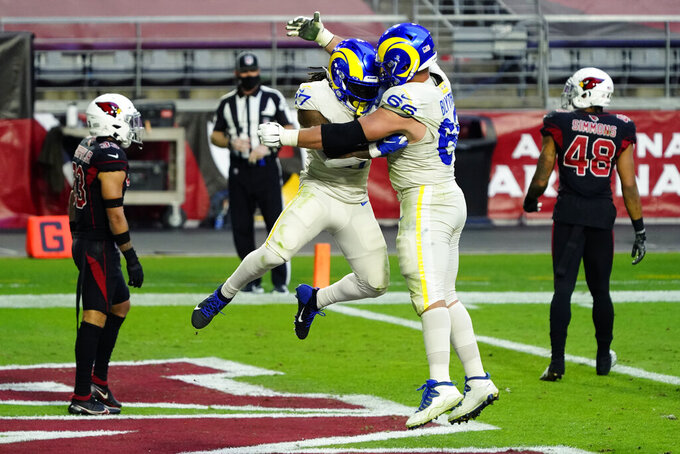 Los Angeles Rams running back Darrell Henderson (27) celebrates his touchdown run with Los Angeles Rams center Austin Blythe (66) during the second half of an NFL football game, Sunday, Dec. 6, 2020, in Glendale, Ariz. (AP Photo/Rick Scuteri)