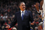 Kentucky coach John Calipari talks to his players during the first half of an NCAA college basketball game against Texas Tech, Saturday, Jan. 25, 2020, in Lubbock, Texas. (AP Photo/Brad Tollefson)