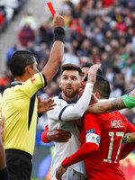 Argentina's Lionel Messi, center, and Chile's Gary Medel, right, scuffle as referee Mario Diaz, from Paraguay, left, shows the red card to both of them during Copa America third-place soccer match at the Arena Corinthians in Sao Paulo, Brazil, Saturday, July 6, 2019. (AP Photo/Victor R. Caivano)