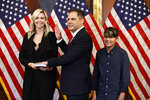 Rep. Mike Garcia, R-Calif., center, joined by his wife Rebecca and son Preston, participates in a ceremonial swearing-in with House Speaker Nancy Pelosi of Calif., on Capitol Hill in Washington, Tuesday, May 19, 2020. (AP Photo/Patrick Semansky)