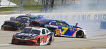 Michael Annett (1), Garrett Smithly (0) and Justin AllGaier (7) collide in the backstretch during a NASCAR Xfinity Series auto race at Talladega Superspeedway in Talladega, Ala., Saturday, April 27, 2019. (AP Photo/Greg McWilliams)