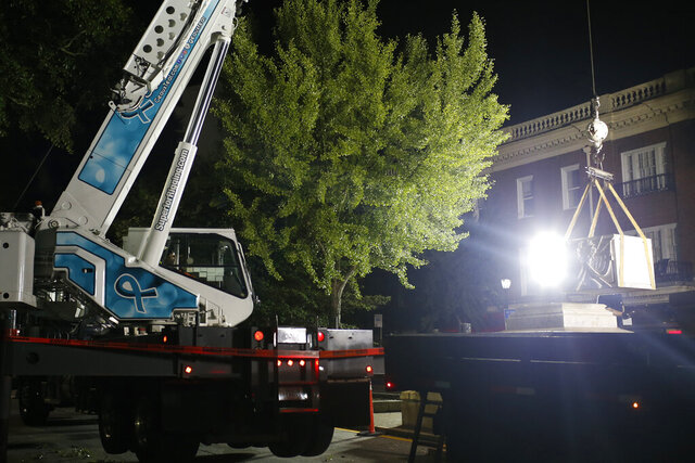 Workers continue removing the downtown Confederate monument in Athens, Ga, early in the morning on Tuesday, Aug. 11, 2020. (Joshua L. Jones/Athens Banner-Herald via AP)