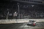 Austin Hill crosses the finish line to win the NASCAR Truck Series auto race Friday, July 9, 2021, at Knoxville Raceway in Knoxville, Iowa. (Joseph Cress/Iowa City Press-Citizen via AP)