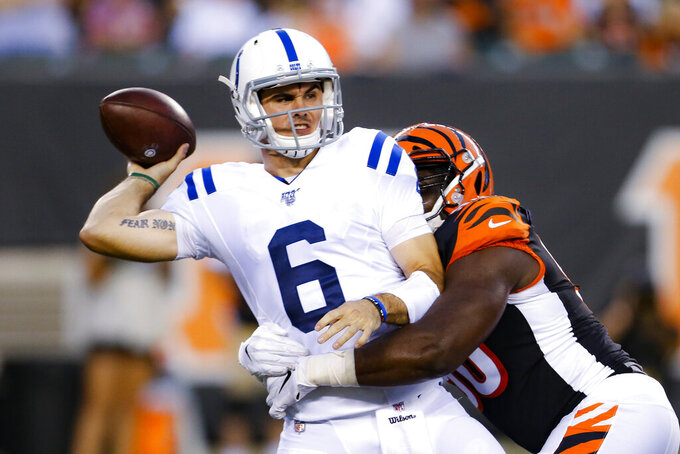 Indianapolis Colts quarterback Chad Kelly (6) is sacked by Cincinnati Bengals defensive end Dare Odeyingbo during the first half of an NFL preseason football game Thursday, Aug. 29, 2019, in Cincinnati. (AP Photo/Gary Landers)