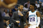 Charlotte Hornets coach James Borrego discusses a play with Kobi Simmons during the first half of an NBA preseason basketball game in Charlotte, N.C., Wednesday, Oct. 16, 2019. (AP Photo/Bob Leverone)