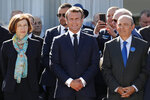 French President Emmanuel Macron, center, French Defense Minister Florence Parly, left, and Eric Trappier, Chairman and CEO of Dassault Aviation, attend the 53rd International Paris Air Show at Le Bourget Airport near Paris, France, Monday June 17, 2019. The world's aviation elite are gathering at the Paris Air Show with safety concerns on many minds after two crashes of the popular Boeing 737 Max. (Benoit Tessier/Pool via AP)