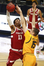 Stanford forward Oscar da Silva shoots against California forward Grant Anticevich during the first half of an NCAA college basketball game in Berkeley, Calif., Thursday, Feb. 4, 2021. (AP Photo/Jed Jacobsohn)