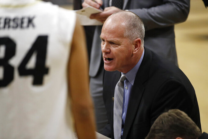 Colorado head coach Tad Boyle confers with his players during a timeout in the second half of an NCAA college basketball game against California, Thursday, Feb. 6, 2020, in Boulder, Colo. (AP Photo/David Zalubowski)