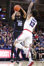 San Diego guard Isaiah Wright (22) shoots while defended by Gonzaga guard Josh Perkins (13) during the first half of an NCAA college basketball game in Spokane, Wash., Saturday, Feb. 2, 2019. (AP Photo/Young Kwak)