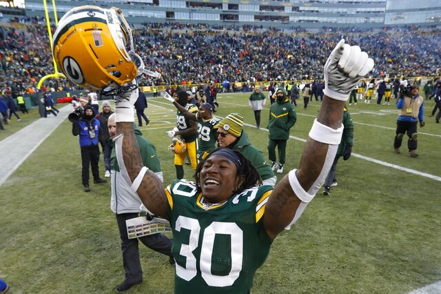 Green Bay Packers' Jamaal Williams celebrates as he leaves the field after an NFL football game against the Chicago Bears Sunday, Dec. 15, 2019, in Green Bay, Wis. The Packers won 21-13. (AP Photo/Mike Roemer)