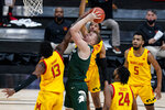 Michigan State forward Thomas Kithier (15) is fouled while shooting by Maryland guard Hakim Hart (13) in the first half of an NCAA college basketball game at the Big Ten Conference tournament in Indianapolis, Thursday, March 11, 2021. (AP Photo/Michael Conroy)