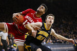 Indiana forward Juwan Morgan, left, fights for a rebound with Iowa forward Nicholas Baer during the first half of an NCAA college basketball game Friday, Feb. 22, 2019, in Iowa City, Iowa. (AP Photo/Charlie Neibergall)