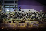 Flowers and notes are displayed as people pay their respects for protesters who were injured on Aug 31 outside Prince Edward station, in Hong Kong on Wednesday, Sept. 4, 2019. Hong Kong Chief Executive Carrie Lam has announced the government will formally withdraw an extradition bill that has sparked months of demonstrations in the city, bowing to one of the protesters' demands. The bill would have allowed Hong Kong residents to be sent to mainland China for trials. It sparked massive protests that have become increasingly violent and caused the airport to shut down earlier this month. (AP Photo/Jae C. Hong)