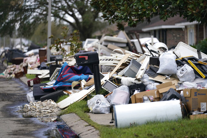 Piles of debris sit curbside as people gut their flooded homes in the aftermath of Hurricane Ida in LaPlace, La., Tuesday, Sept. 7, 2021. (AP Photo/Gerald Herbert)