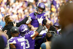 Minnesota Vikings kicker Greg Joseph (1) celebrates with teammates after kicking a 54-yard field goal on the final play of an NFL football game against the Detroit Lions, Sunday, Oct. 10, 2021, in Minneapolis. The Vikings won 19-17. (AP Photo/Bruce Kluckhohn)