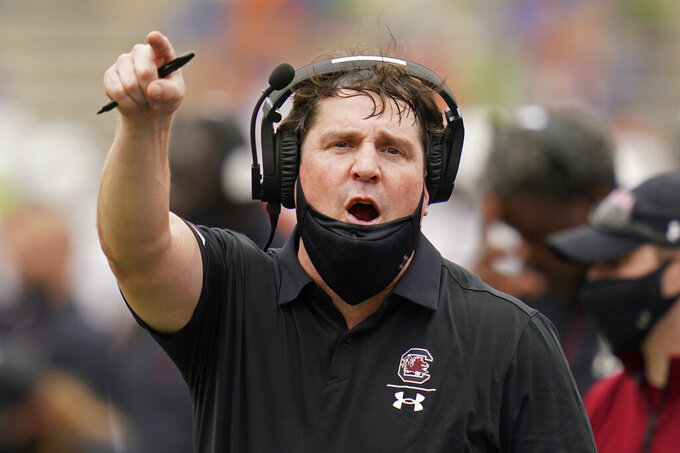 South Carolina head coach Will Muschamp has words with an official during the first half of an NCAA college football game against Florida, Saturday, Oct. 3, 2020, in Gainesville, Fla. (AP Photo/John Raoux, Pool)