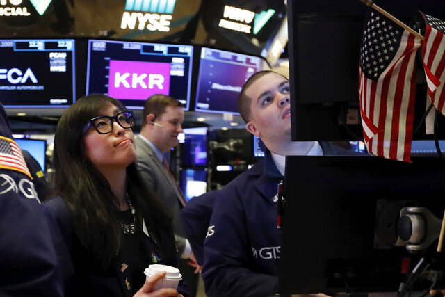 FILE - In this Feb. 24, 2020, file photo specialist Erica Fredrickson works with a colleague on the floor of the New York Stock Exchange. The U.S. stock market opens at 9:30 a.m. EST on Tuesday, Feb. 25. (AP Photo/Richard Drew, File)