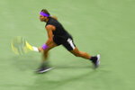 Rafael Nadal, of Spain, chases down a shot from Matteo Berrettini, of Italy, during the men's singles semifinals of the U.S. Open tennis championships Friday, Sept. 6, 2019, in New York. (AP Photo/Sarah Stier)