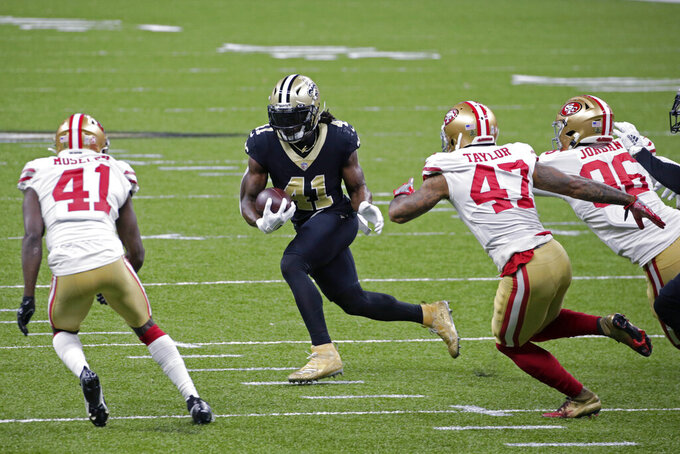 New Orleans Saints running back Alvin Kamara (41) is pursued by San Francisco 49ers cornerbacks Jamar Taylor (47), Emmanuel Moseley (41) and defensive end Dion Jordan in the first half of an NFL football game in New Orleans, Sunday, Nov. 15, 2020. (AP Photo/Butch Dill)