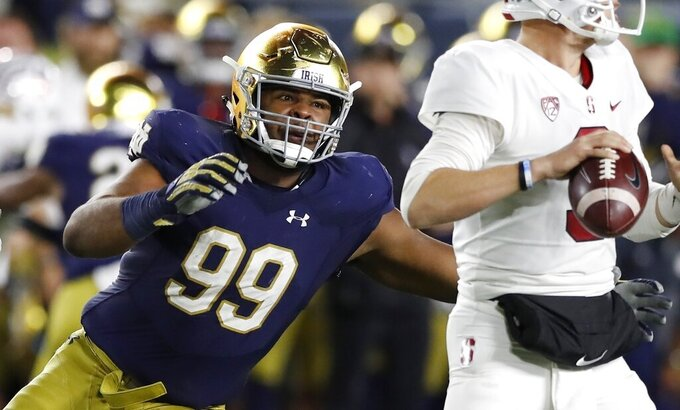 FILE - In this Sept. 29, 2018, file photo, Notre Dame defensive lineman Jerry Tillery rushes Stanford quarterback K.J. Costello during the second half of an NCAA college football game, in South Bend, Ind. Tillery is a possible pick in the 2019 NFL Draft. (AP Photo/Carlos Osorio, File)