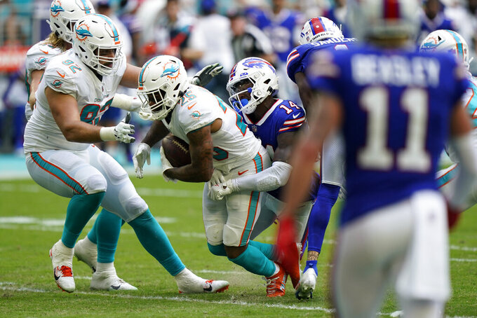 Miami Dolphins cornerback Xavien Howard (25) intercepts a pass intended for Buffalo Bills wide receiver Stefon Diggs (14) during the first half of an NFL football game, Sunday, Sept. 19, 2021, in Miami Gardens, Fla. (AP Photo/Wilfredo Lee)