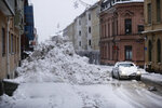 A pile of snow in the central parts of Sundsvall, a town about 370 miles north of Stockholm, Tuesday Jan. 12, 2021.  Some thousands of households across northern Sweden and southern Finland are without power Wednesday Jan. 13, 2021, after heavy snowfall and icy temperatures swept across the region. (Mats Andersson / TT via AP)