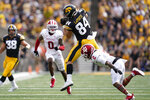 Iowa tight end Sam LaPorta (84) catches a pass over Indiana defensive back Reese Taylor (2) during the first half of an NCAA college football game, Saturday, Sept. 4, 2021, in Iowa City, Iowa. (AP Photo/Charlie Neibergall)