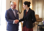 Britain's Prince Charles shakes hands with New Zealand Prime Minister Jacinda Ardern at Government House in Auckland, New Zealand, Tuesday, Nov. 19, 2019. Prince Charles and his wife Camilla are on a weeklong trip, during which they plan to visit the city of Christchurch and the historic treaty grounds at Waitangi, where the nation's founding document was signed. (Patrice Allen/Pool Photo via AP)