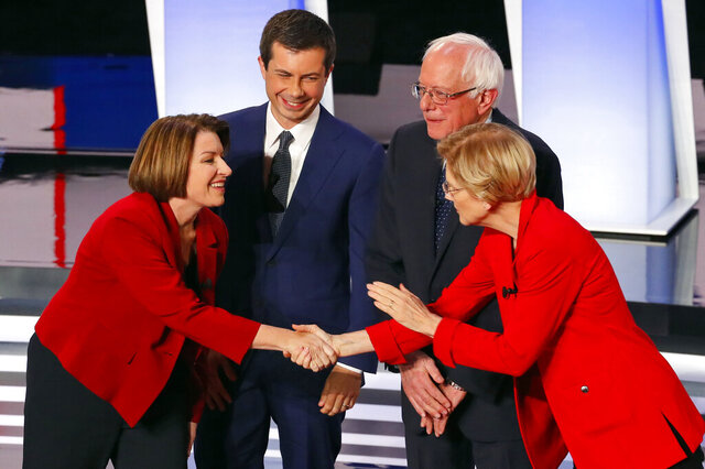 FILE - In this July 30, 2019, file photo, from left, Sen. Amy Klobuchar, D-Minn., South Bend Mayor Pete Buttigieg, Sen. Bernie Sanders, I-Vt., and Sen. Elizabeth Warren, D-Mass., greet each other before the first of two Democratic presidential primary debates hosted by CNN at the Fox Theatre in Detroit. Democratic presidential hopefuls are offering different approaches to the central challenge of how to talk about the polarizing debate over abortion. (AP Photo/Paul Sancya, File)